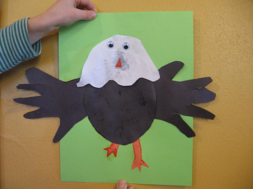 child with letter E handprint eagle