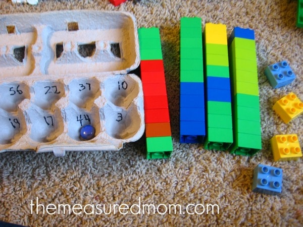 child practicing counting with blocks