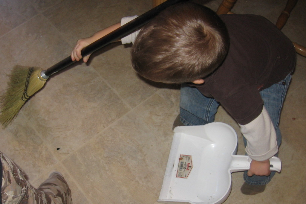 child sweeping