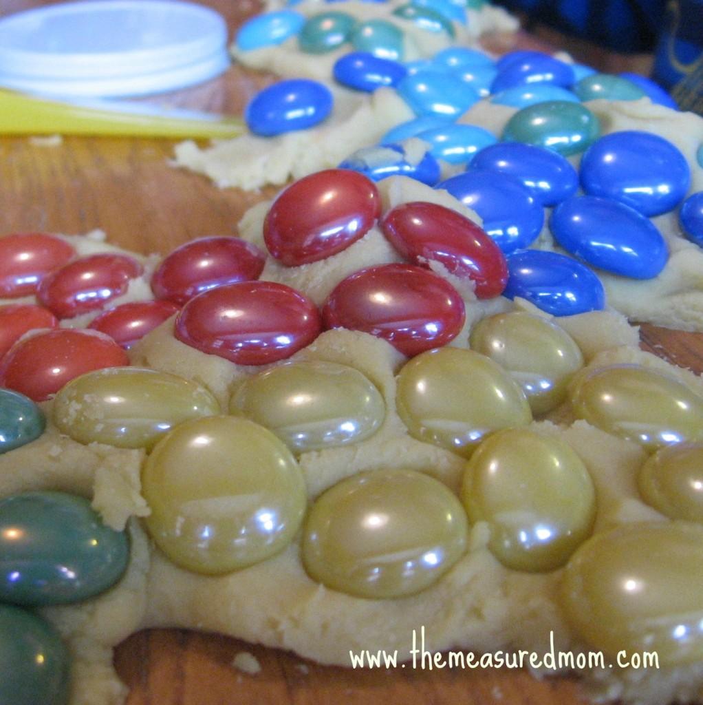 gems pressed into play dough