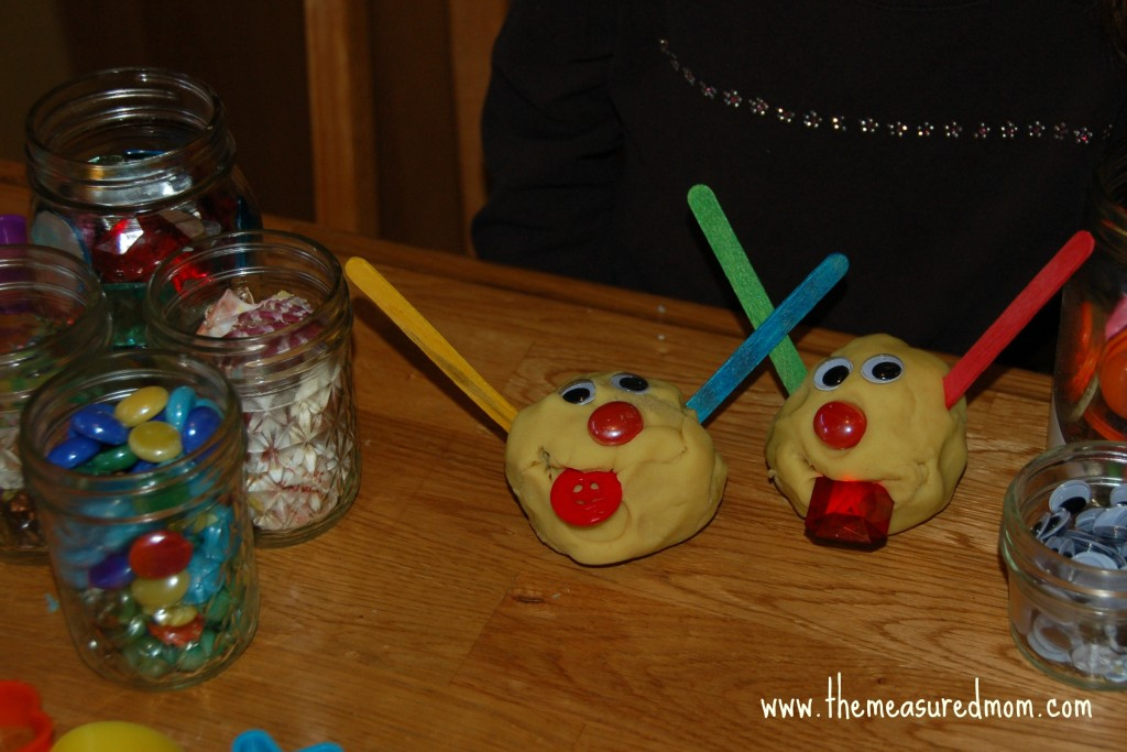 child with play dough monsters