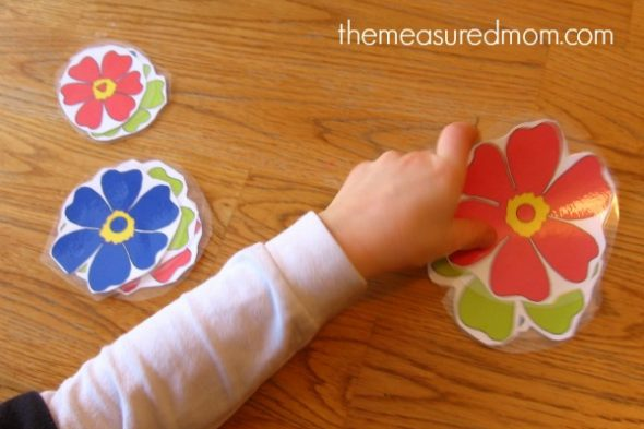 child sorting flower cards