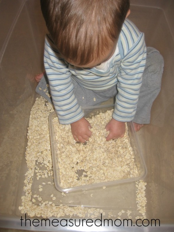child squeezing oats