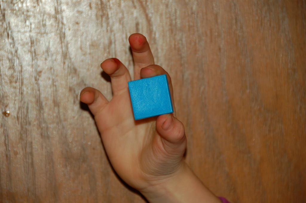 child holding tile