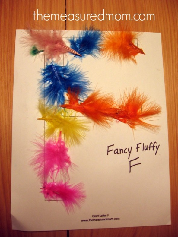 letter F block letter covered with feathers