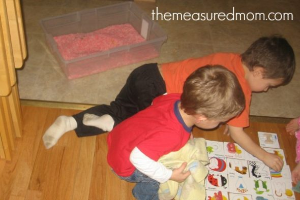 children playing with letters and letter cards