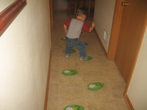 child jumping on lily pad cards