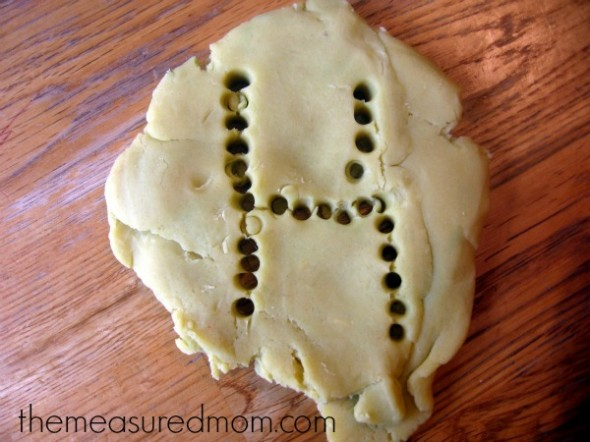 letter H made with holes in playdough