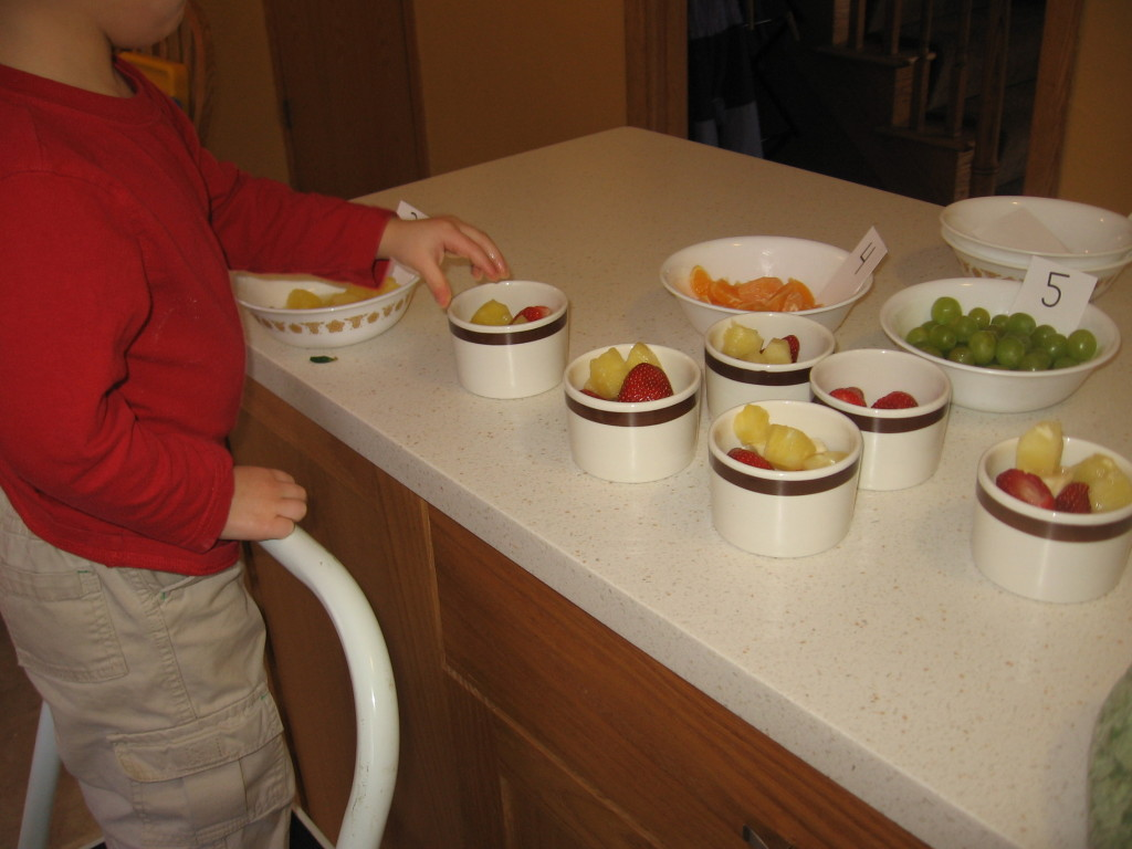 child making fruit salad