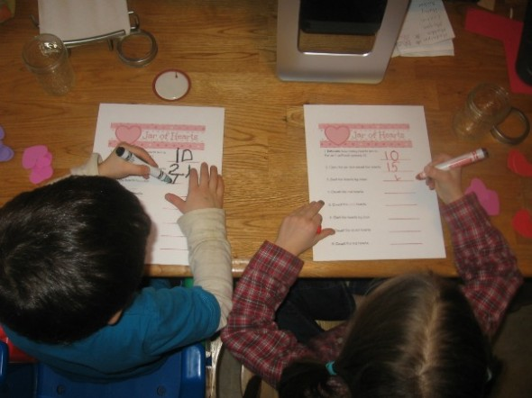 children writing on letter H jar of hearts worksheet