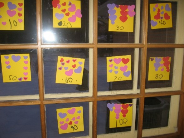 heart stickers on paper on windows