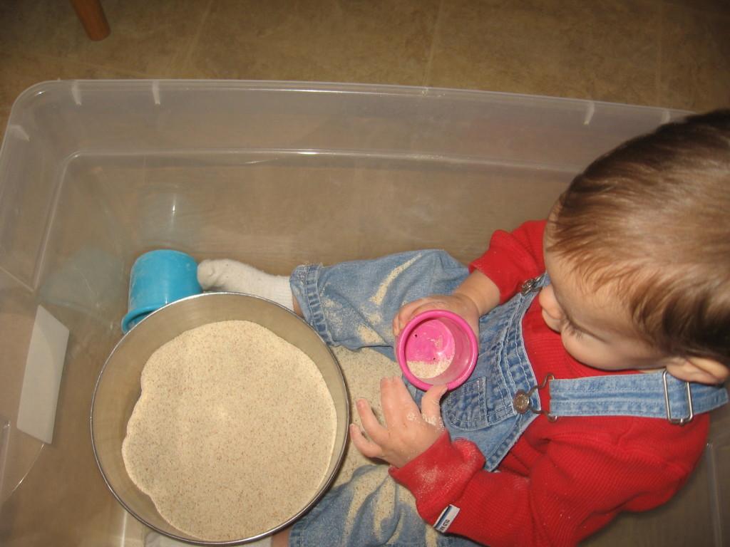 """baby playing in """"sandbox"""""""