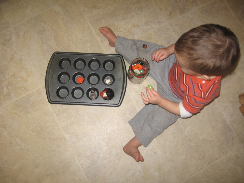 child holding button