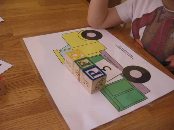 child with counting mat with blocks