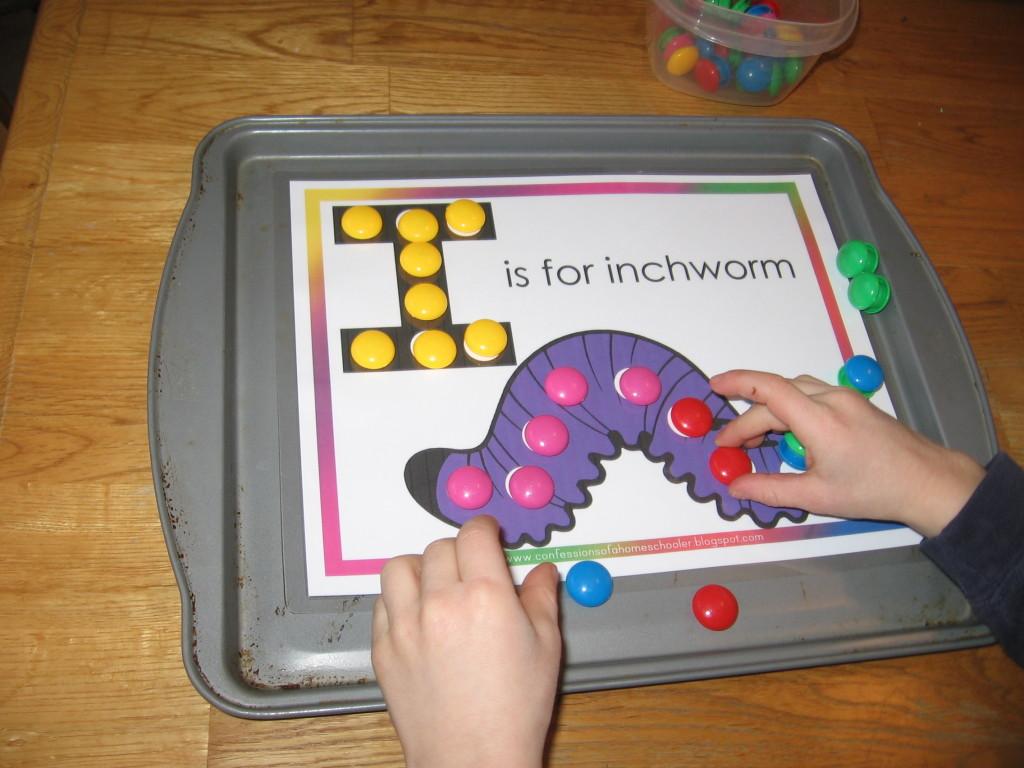 child placing magnets on letter I worksheet