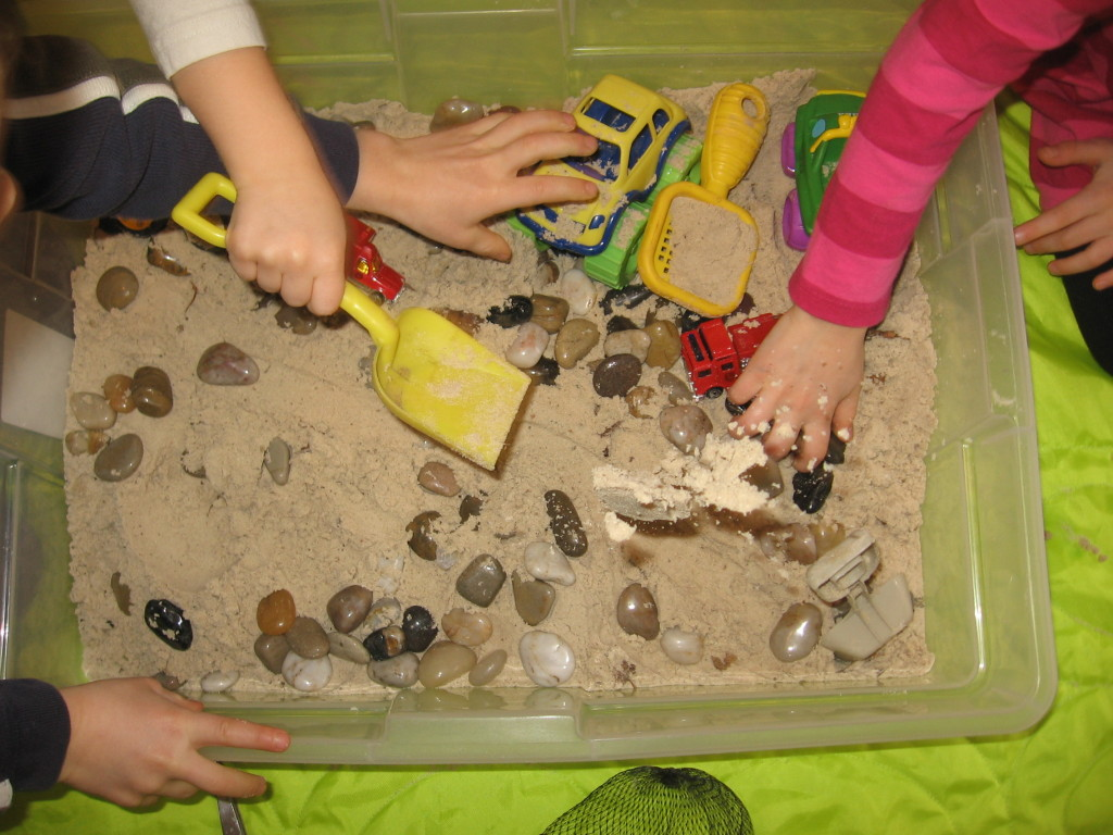 children playing with sandbox