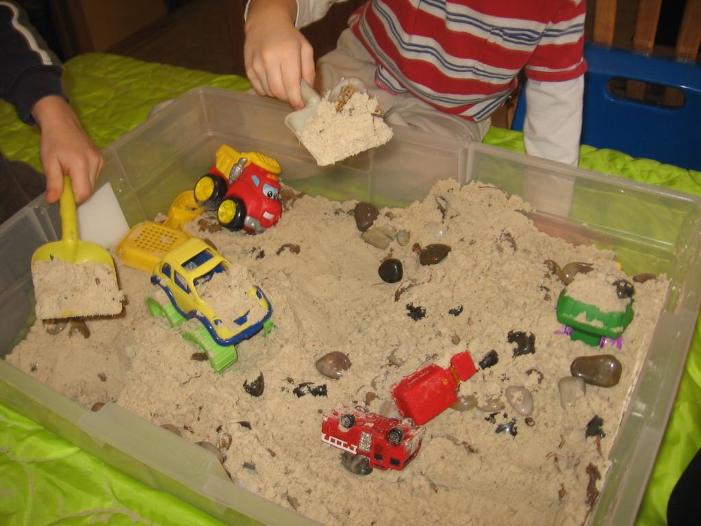 children dumping sand