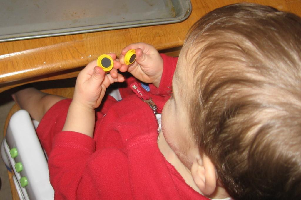 child examining magnets