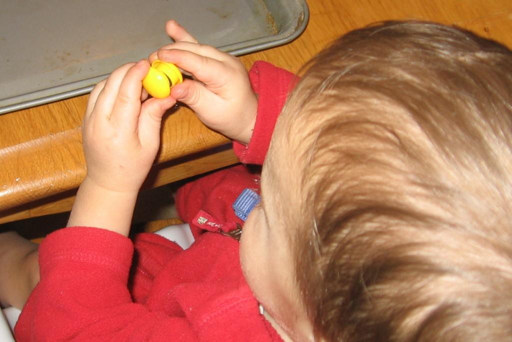 child sticking magnets together