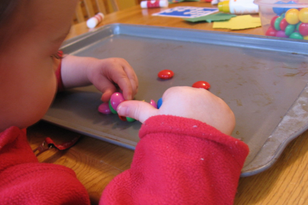 child playing with magnets