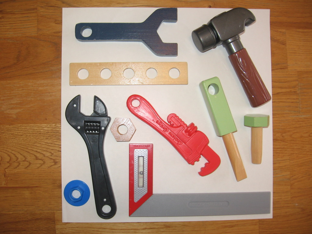 toy tools on paper