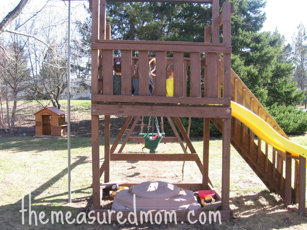 children sitting on playset