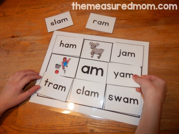 child with word family mat and cards