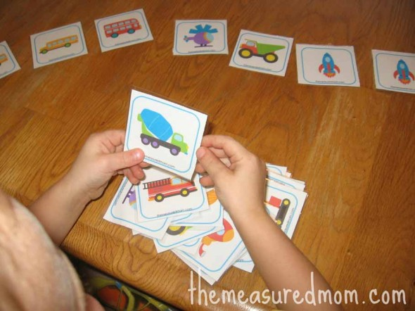 child playing matching transportation memory game