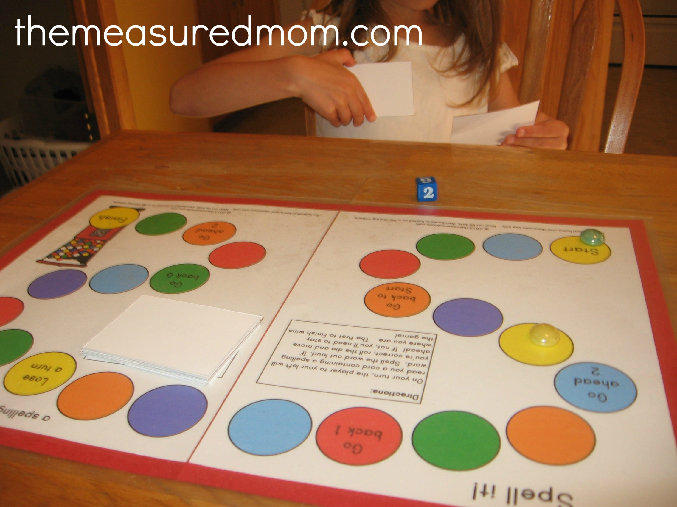 child playing printable spelling game