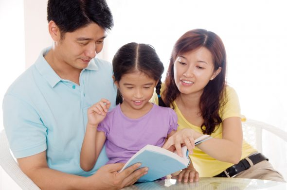Asian family reading at home