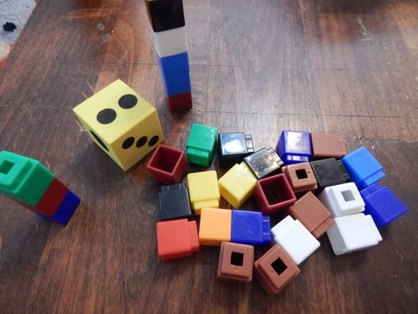 Make measurement a game. Take turns rolling a die and adding that many cubes to your tower. Whose is bigger?
