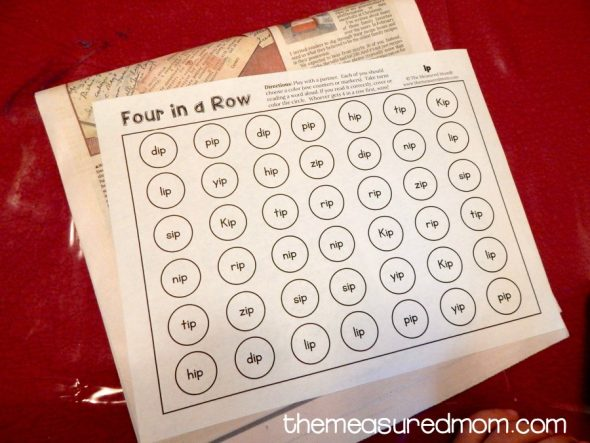 Get our free four-in-a-row games for reading short i words!