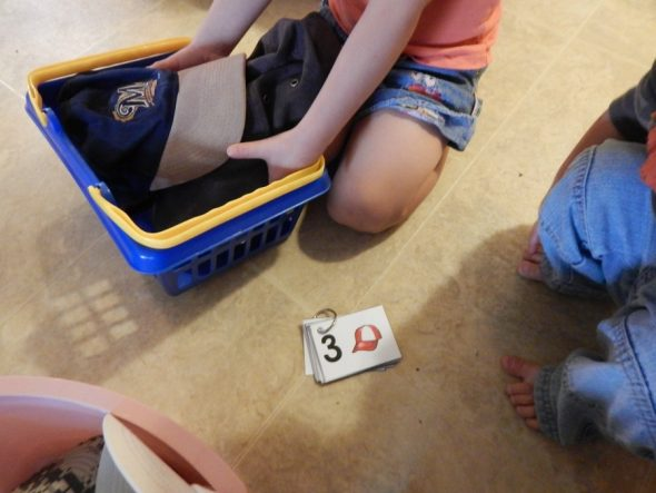 child using number cards
