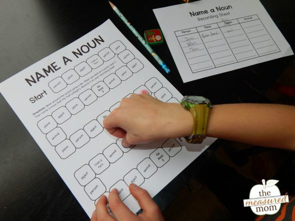 child playing a printable noun game