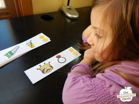 Child practicing rhyming with printable